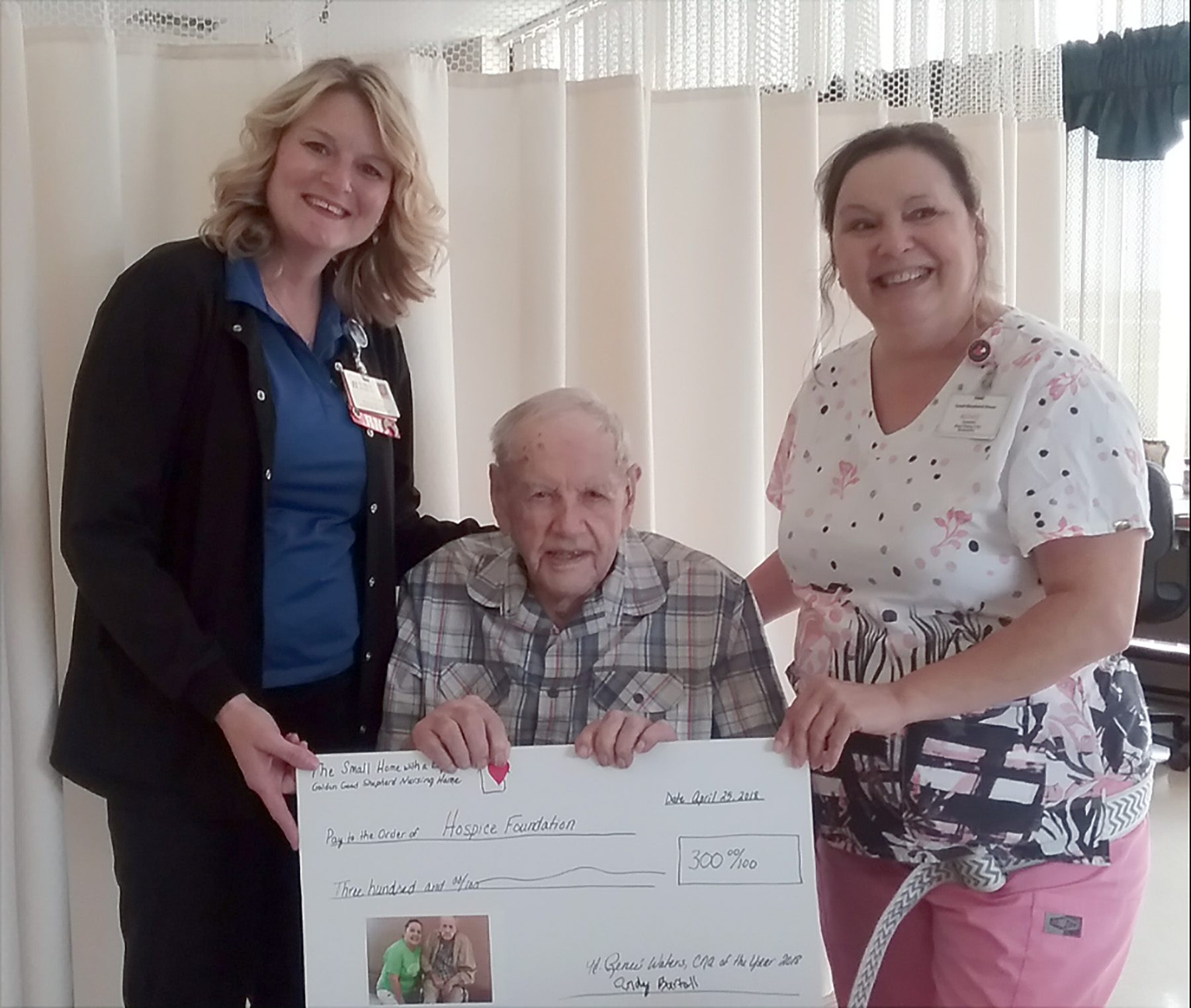 Melinda Thompson Blessing Hospice and 102 year old Andrew Bartell and Golden Good Shepherd Home CNA Renee Waters with $300 donation to Blessing Hospice